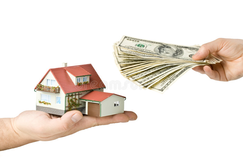 Hands with money and miniature house royalty free stock photography