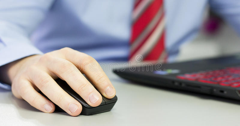 Hands on mouse stock image