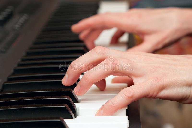 Hands of the musician on a synthesizer royalty free stock photos