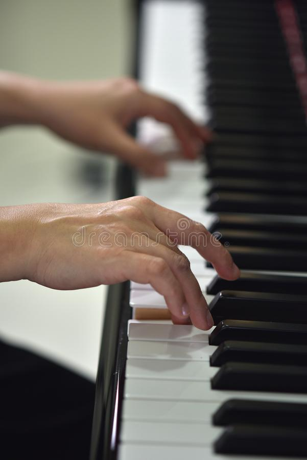 The music hands at the piano stock photos
