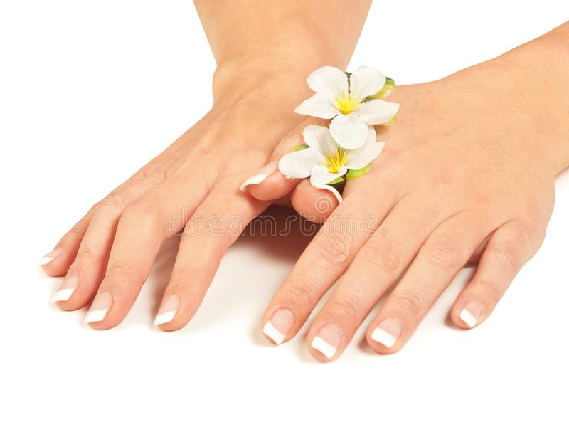 Hands and nails and flowers stock image