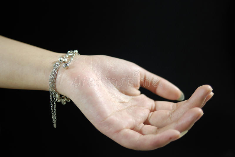 Hands and necklace stock images