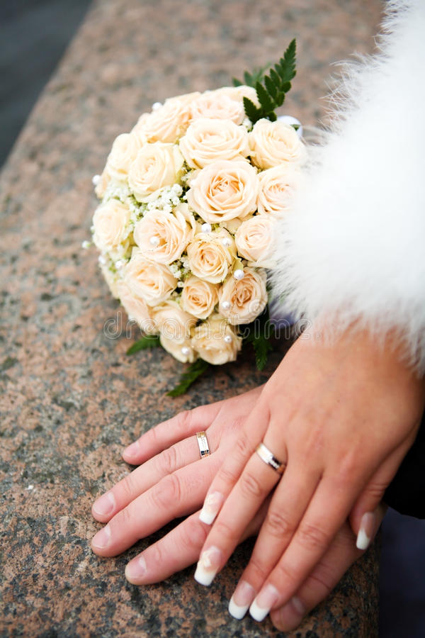 Hands of new married. With golden rings stock image