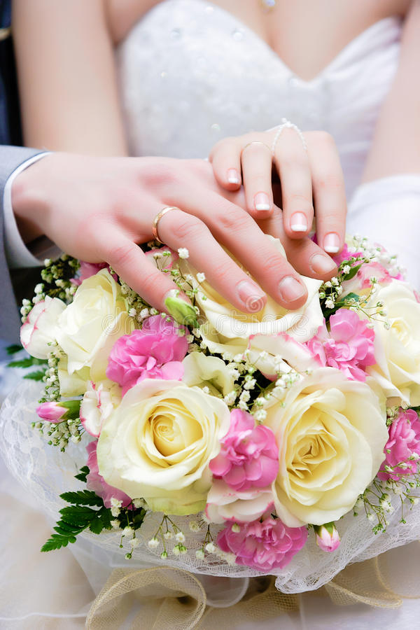 Hands of newlyweds royalty free stock photography