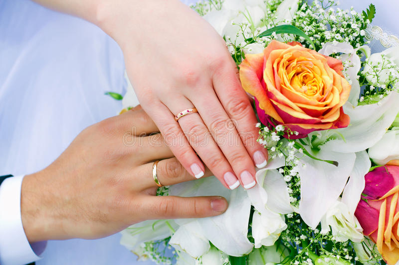 Hands of the newlyweds stock images