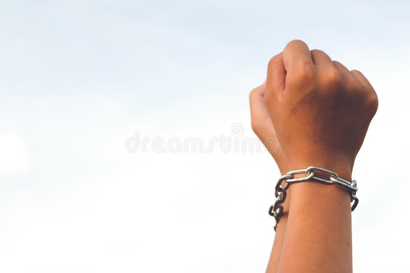 Hands are not free was locked by chain stock photo