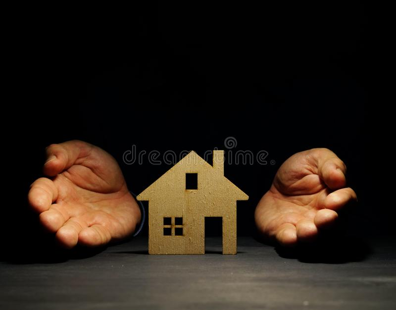 Hands offers model of house. Mortgage concept. royalty free stock images