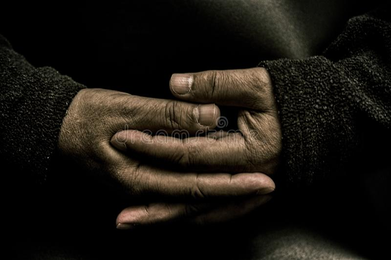 Old Hands. Portrait of hands that intertwine their fingers. The hands of an old man. black and white. Portrait of hands that intertwine their fingers. Depressed royalty free stock image