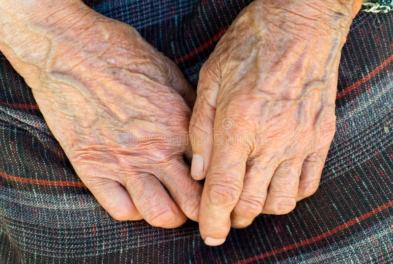 The hands of the old peasant woman stock photos
