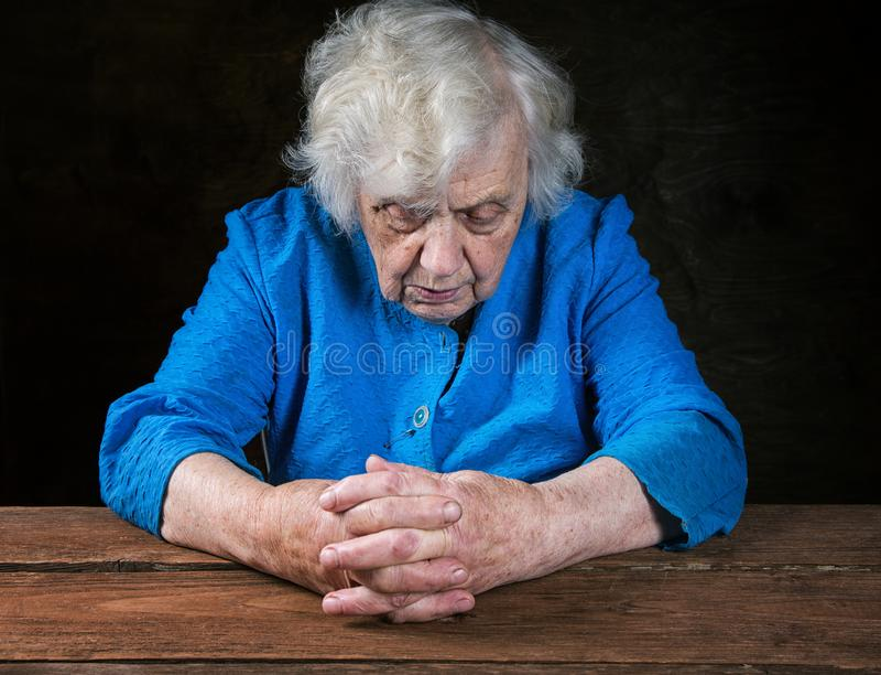 Hands of an old woman close-up stock photos