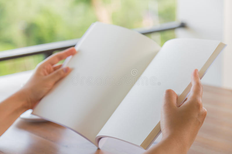 Hands open Blank catalog, magazines,book mock up on wood table stock photo