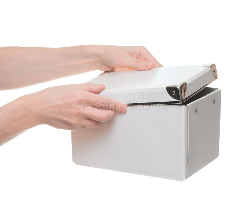Hands open the box