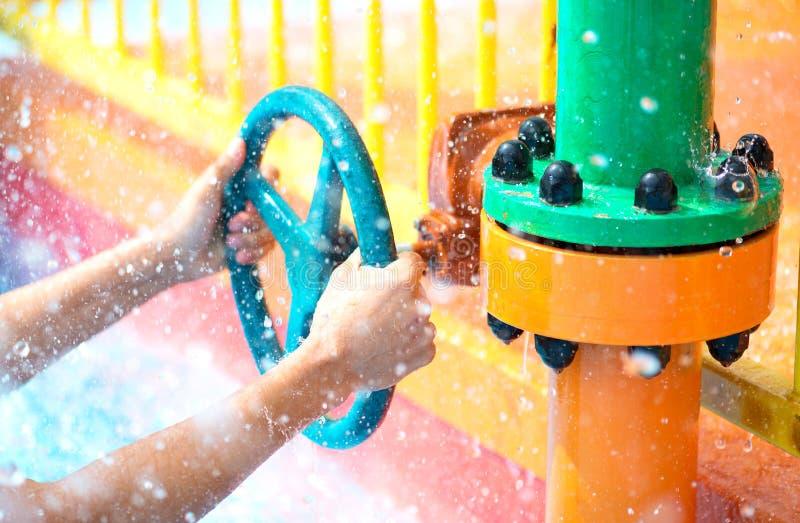 Hands open water valve stock image
