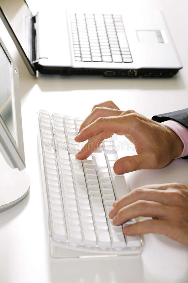 Hands over keyboard stock image