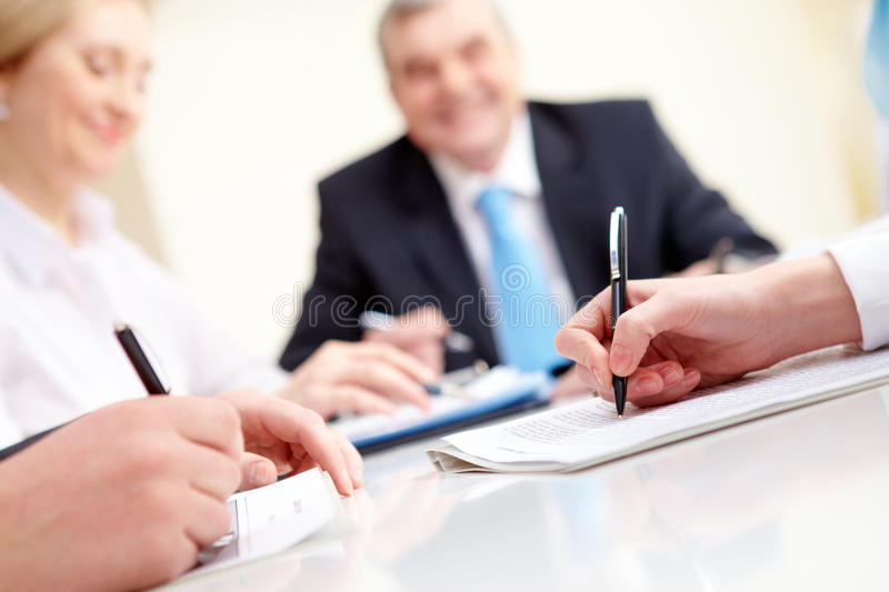 Hands over papers stock photo