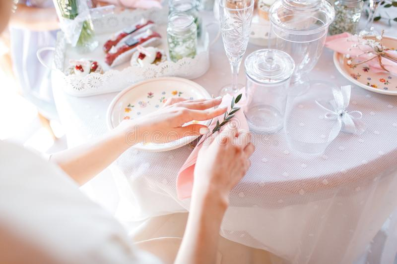 The bride is having breakfast at a beautifully decorated table royalty free stock photos