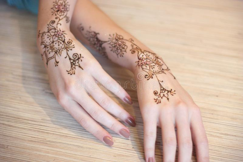 Hands painted with henna stock photos