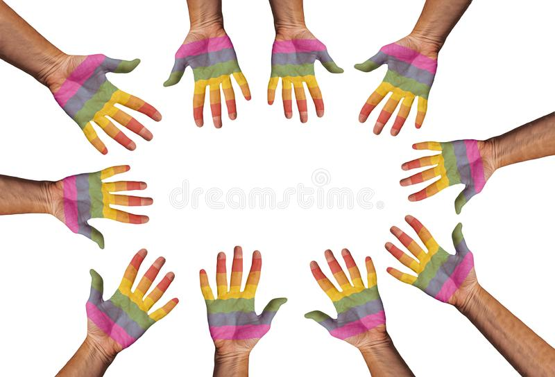 Hands painted in LGBTQ rainbow flag colors reaching out for each others in a circle with copy space. Isolated on white background. royalty free stock photos
