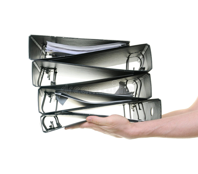 Download Hands Passing A Pile Of Ring Binders Stock Photo - Image: 8747146