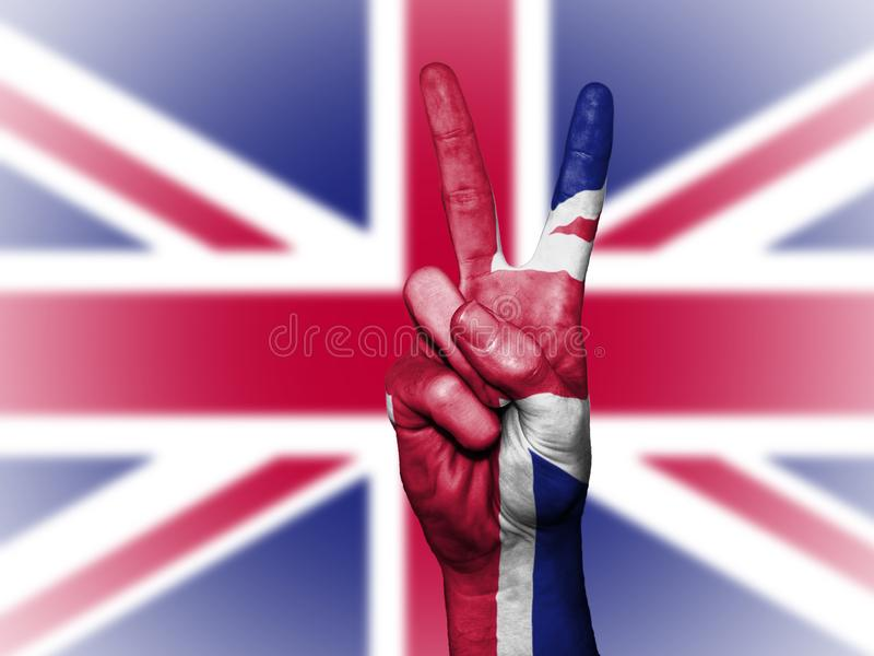 Hands with peace sign against Union Jack