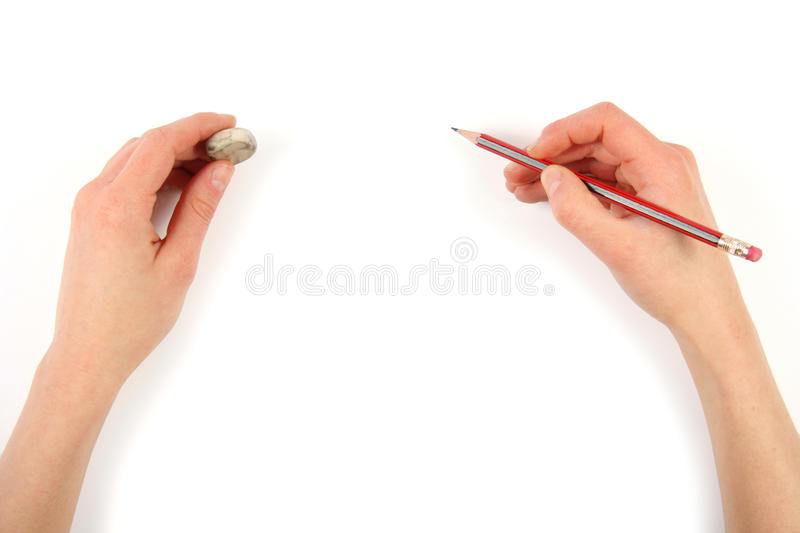 Hands with pencil and erase. Isolated on white background stock images