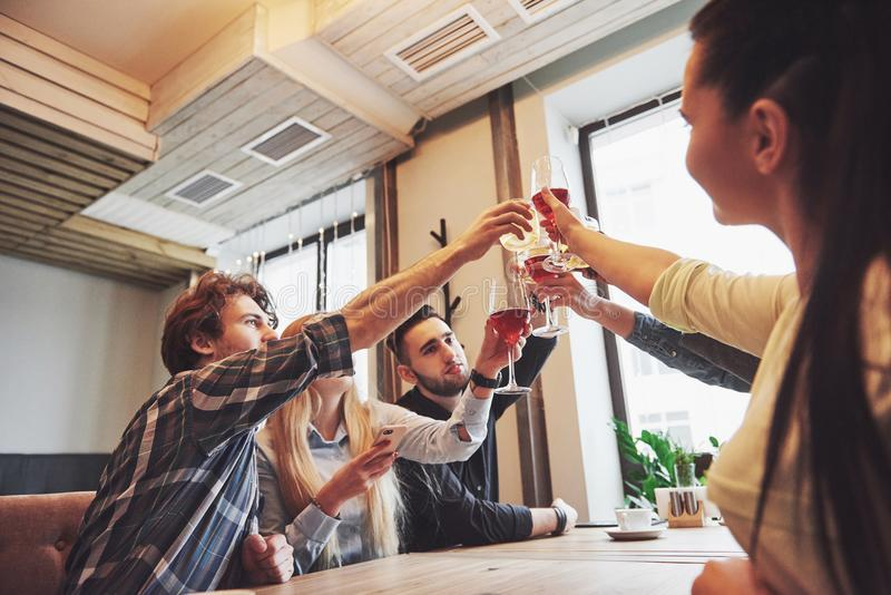 Hands of people with glasses of whiskey or wine, celebrating and toasting in honor of the wedding or other celebration royalty free stock photos