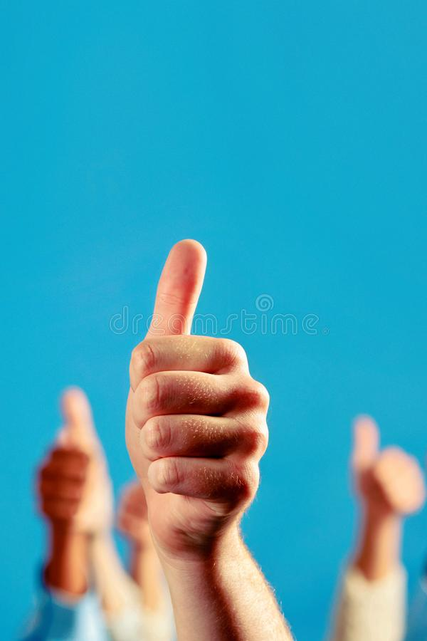 Hands of people holds many thumbs up, great work stock images