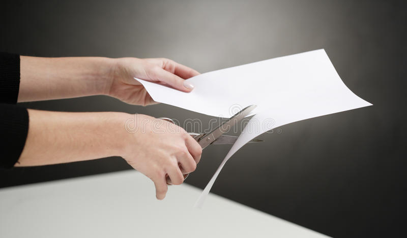 Hands of person cutting paper stock images