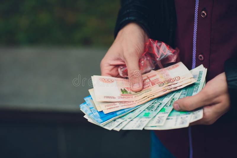 Hands of person proposing money to you - closeup shot. Hands of person proposing money to you - closeup shot royalty free stock photo