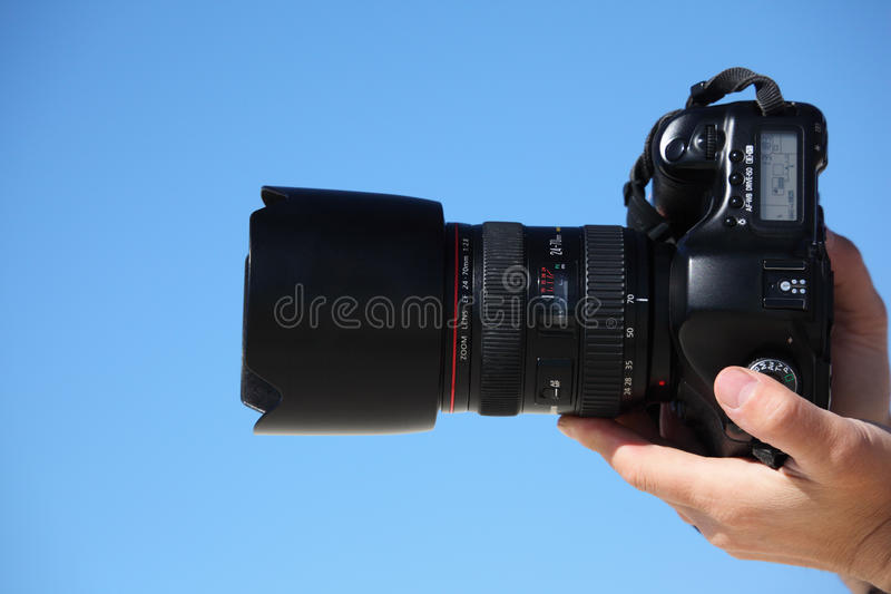 Hands with photo camera royalty free stock photo