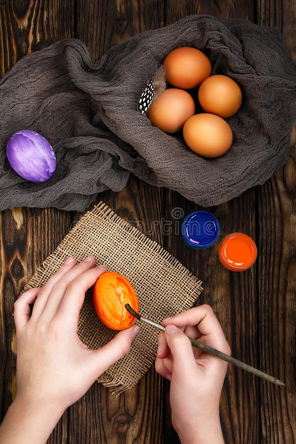 Colouring eggs for eastertime at home royalty free stock photography
