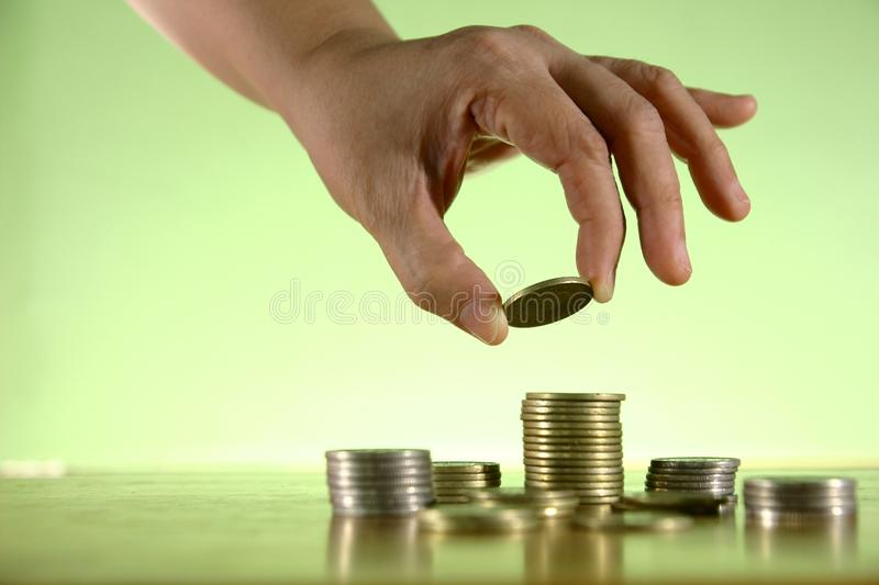 Hands Piling Coins royalty free stock photography