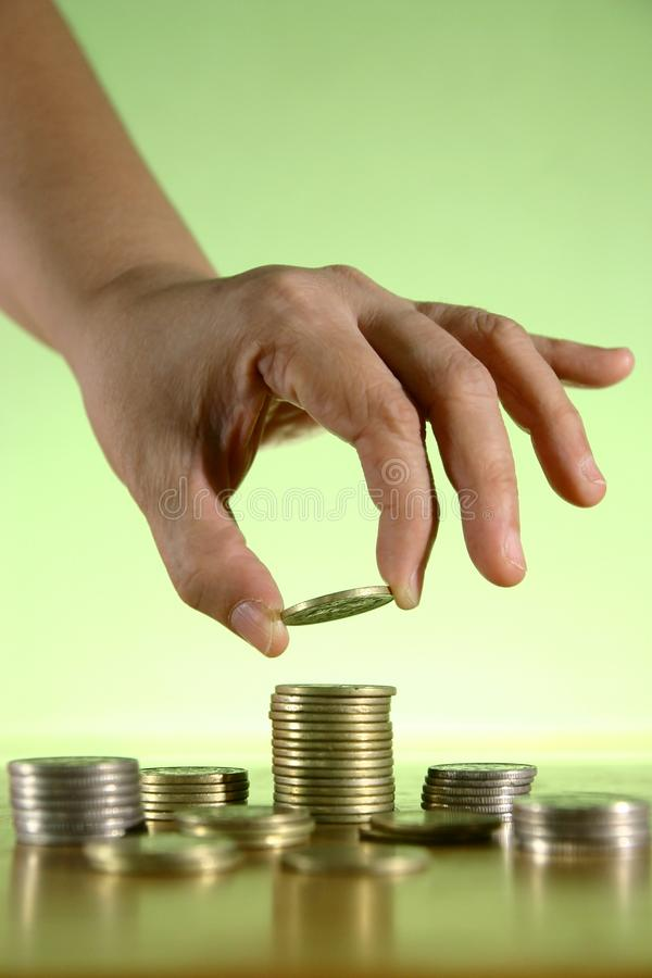 Hands Piling Coins royalty free stock photo