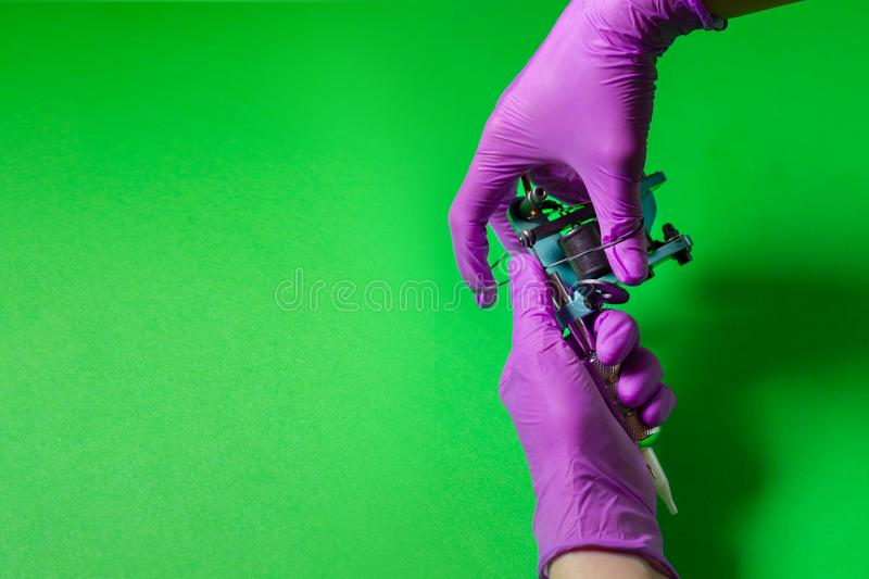Hands Hold A Blue Tattoo Machine stock images