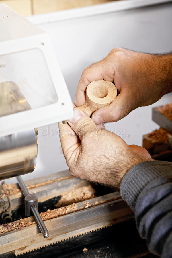 Hands at pipe processing on lathe royalty free stock image