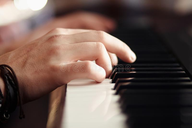 Hands play on a modern musical synthesizer stock photos