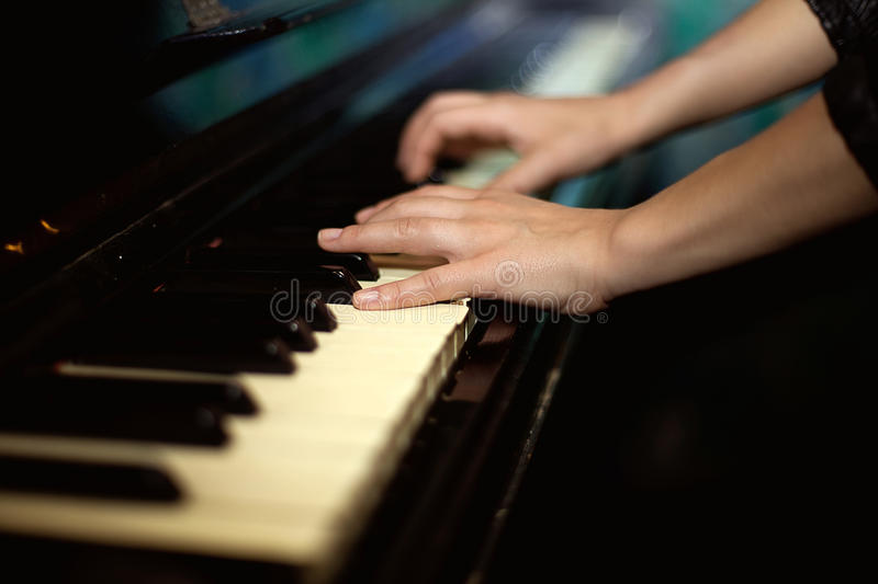 Hands playing music on the piano. Hands playing music on piano royalty free stock photos