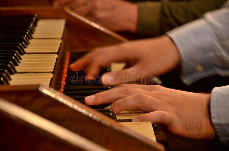 Hands playing organ royalty free stock image