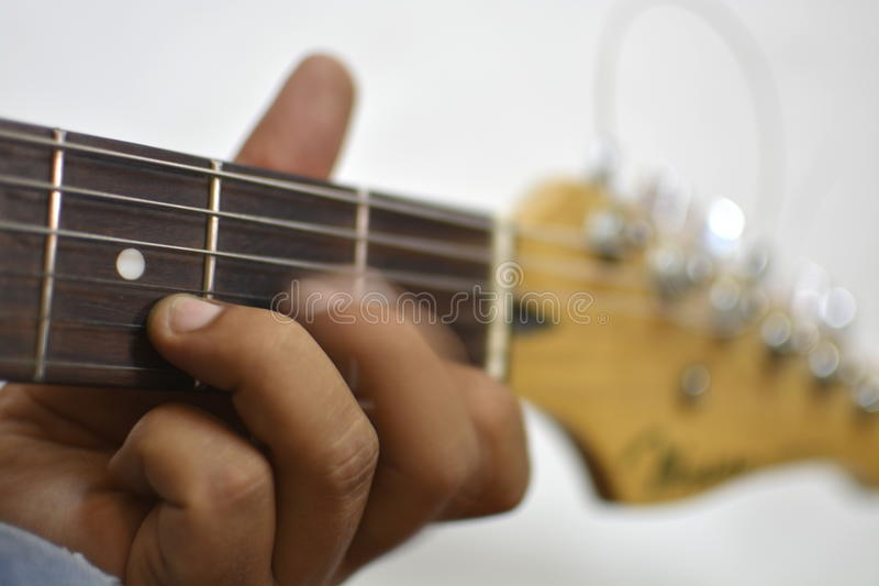 Hands playing guitar stock image