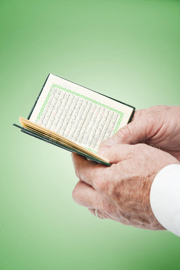 Hands With Pocket Quran stock photos