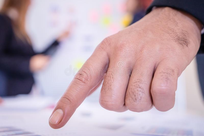 Hands pointing on chart sheet for business meeting stock photo