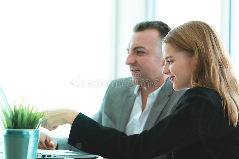 Hands pointing on Computer in business meeting stock photography
