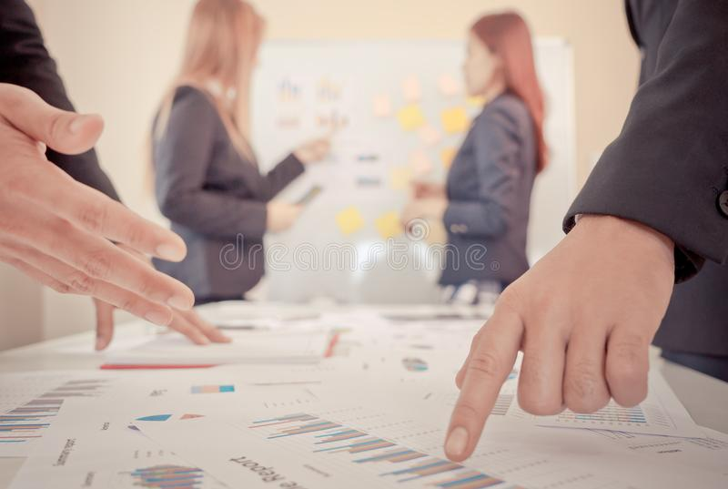 Hands pointing on data chart for business meeting royalty free stock image