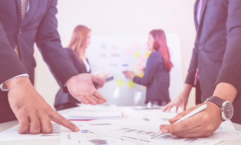 Hands pointing on data chart sheet in business meeting royalty free stock images