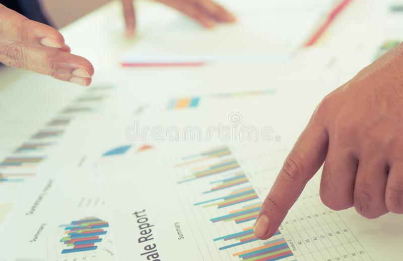 Hands pointing on data chart sheet in business meeting stock photos