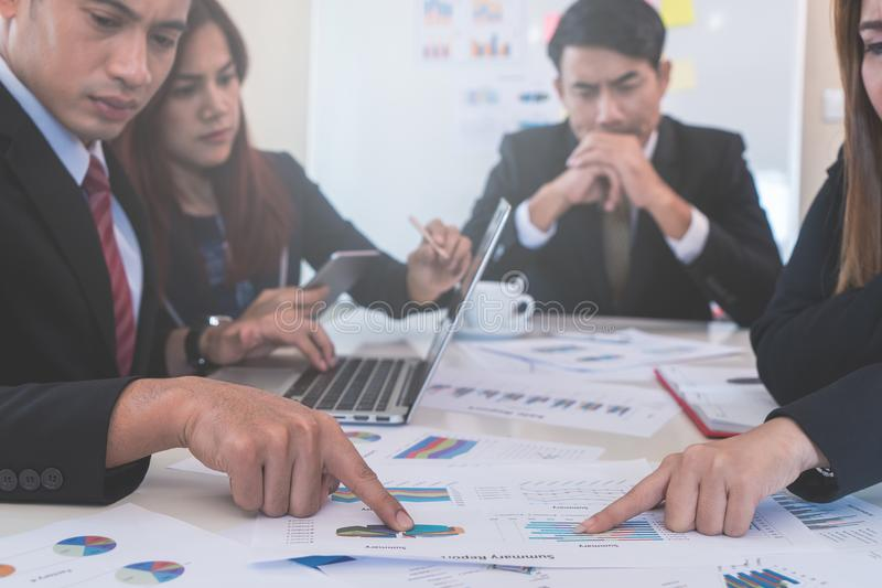 Hands pointing on data chart sheet in business meeting stock photography