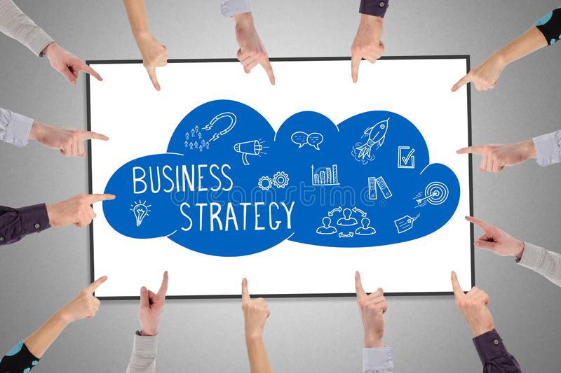 Business strategy concept on a whiteboard. Hands pointing to business strategy concept royalty free stock photos