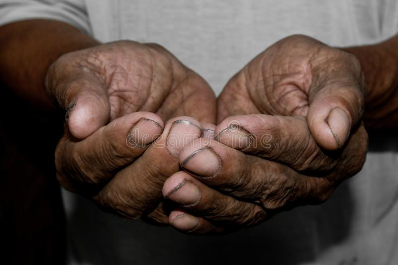 Hands poor poverty elder man begging you for help. Concept hunge. R people or poverty. Selective focus. Poverty in retirement. alms penny law money ransom royalty free stock images