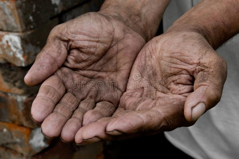 Hands poor poverty elder man begging you for help. Concept hunge. R people or poverty. Selective focus. Poverty in retirement. alms penny law money ransom stock photography