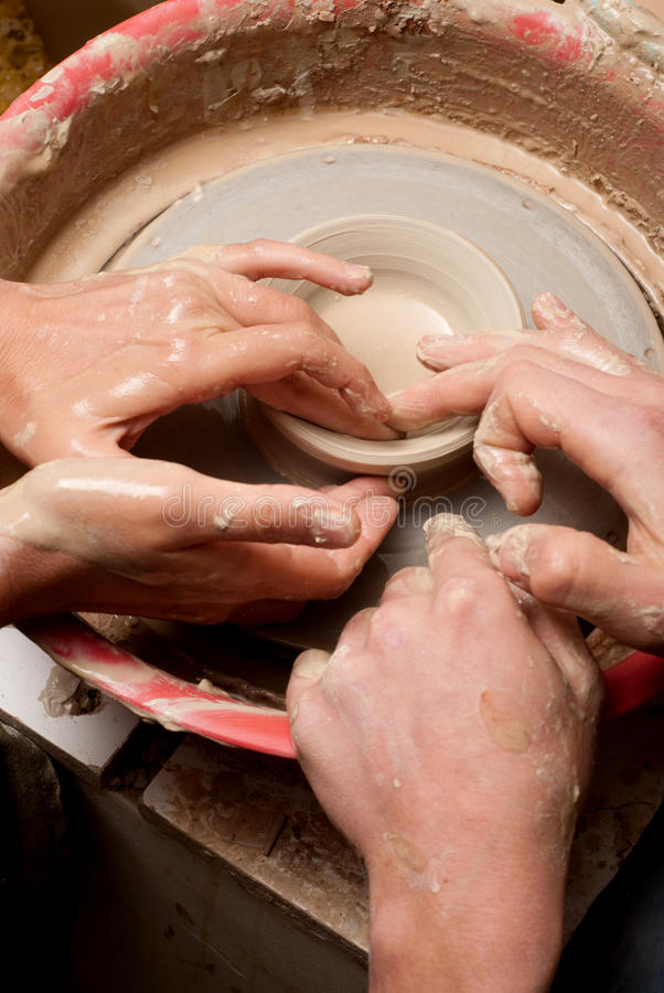 Download Hands Of A Potter, Creating An Earthen Jar On The Circle Stock Photo - Image: 33677856